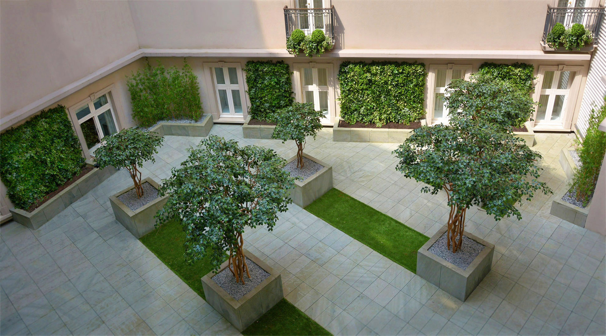410 fake landscapes corinthia hotel courtyard UV camellia trees, bamboo, living walls and window boxes